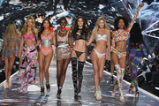 (L-R) Nadine Leopold, Shanina Shaik, Herieth Paul, Barbara Fialho, Toni Garrn, and Cheyenne Maya Carty walk the runway during the 2018 Victoria's Secret Fashion Show at Pier 94 on November 8, 2018 in New York City.