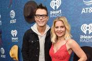 (EDITORIAL USE ONLY. NO COMMERCIAL USE) Hosts Bobby Bones (L) and Candace Cameron Bure arrive at the 2018 iHeartCountry Festival By AT&T at The Frank Erwin Center on May 5, 2018 in Austin, Texas.