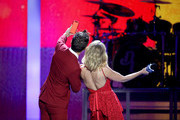 (EDITORIAL USE ONLY. NO COMMERCIAL USE) Hosts Bobby Bones (L) and Candace Cameron Bure pose for a selfie photo onstage during the 2018 iHeartCountry Festival By AT&T at The Frank Erwin Center on May 5, 2018 in Austin, Texas.