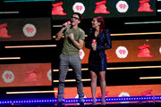 Bobby Bones (L) and Sharna Burgess speak onstage during the 2018 iHeartRadio Music Festival at T-Mobile Arena on September 21, 2018 in Las Vegas, Nevada.