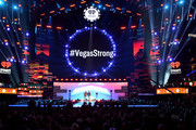 """#VegasStrong"" is projected on a video screen while Jason Aldean (L) and Bobby Bones speak onstage during the 2018 iHeartRadio Music Festival at T-Mobile Arena on September 21, 2018 in Las Vegas, Nevada."