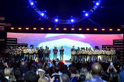 Jason Aldean (center L) and Bobby Bones (center R) honor first responders onstage during the 2018 iHeartRadio Music Festival at T-Mobile Arena on September 21, 2018 in Las Vegas, Nevada.