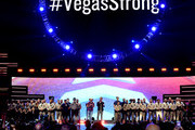 '#VegasStrong' is displayed on a video screen while Jason Aldean (center R) and Bobby Bones (center L) honor first responders onstage during the 2018 iHeartRadio Music Festival at T-Mobile Arena on September 21, 2018 in Las Vegas, Nevada.