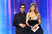 (L-R) Dan Levy and Heidi Klum speak onstage during the 2019 American Music Awards at Microsoft Theater on November 24, 2019 in Los Angeles, California.