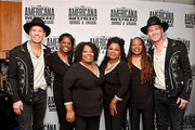 (L-R) Phil Hanseroth, Alfreda McCrary, Ann McCrary, Regina McCrary and Deborah McCrary of The McCrary Sisters and Tim Hanseroth seen backstage during the 2019 Americana Honors & Awards at Ryman Auditorium on September 11, 2019 in Nashville, Tennessee.
