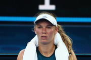 Caroline Wozniacki of Denmark looks on in between games in her first round match against Alison Van Uytvanck of Belgium during day one of the 2019 Australian Open at Melbourne Park on January 14, 2019 in Melbourne, Australia.