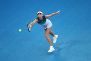 Caroline Wozniacki of Denmark stretches to play a forehand in her first round match against Alison Van Uytvanck of Belgium during day one of the 2019 Australian Open at Melbourne Park on January 14, 2019 in Melbourne, Australia.
