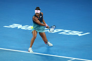 Naomi Osaka of Japan plays a backhand in her Women's Singles Final match against Petra Kvitova of the Czech Republic on day 13 of the 2019 Australian Open at Melbourne Park on January 26, 2019 in Melbourne, Australia.