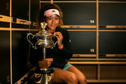 In this handout image provided by Tennis Australia, 2019 Australian Open Women's Singles Final Winner Naomi Osaka of Japan poses with the Daphne Akhurst Memorial Cup Trophy in the locker room after her win during day 13 of the 2019 Australian Open at Melbourne Park on January 27 2019 in Melbourne, Australia.