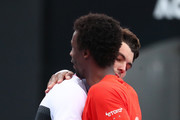 Gael Monfils of France and Taylor Fritz of the United States embrace following their second round match during day three of the 2019 Australian Open at Melbourne Park on January 16, 2019 in Melbourne, Australia.