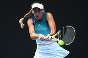 Caroline Wozniacki of Denmark plays a backhand in her third round match against Maria Sharapova of Russia during day five of the 2019 Australian Open at Melbourne Park on January 18, 2019 in Melbourne, Australia.