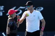 Bethanie Mattek-Sands of the United States and Jamie Murray of Great Britain talk tactics in their Mixed Doubles match against Kristina Mladenovic of France and Robert Lindstedt of Sweden during day eight of the 2019 Australian Open at Melbourne Park on January 21, 2019 in Melbourne, Australia.