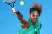 Serena Williams of the United States serves in her fourth round match against Simona Halep of Romania during day eight of the 2019 Australian Open at Melbourne Park on January 21, 2019 in Melbourne, Australia.