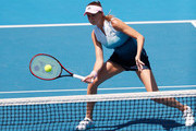 Daniela Hantuchova of Slovakia plays a forehand in her Women's Legends Doubles match with Martina Navratilova of the United States against Mary Joe Fernandez of the United States and Barbara Schett of Austria during day nine of the 2019 Australian Open at Melbourne Park on January 22, 2019 in Melbourne, Australia.