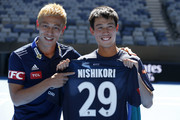 Japanese footballer and Melbourne Victory player Keisuke Honda meets Kei Nishikori during a practice session ahead of the 2019 Australian Open at Melbourne Park on January 11, 2019 in Melbourne, Australia.