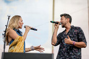 (EDITORIAL USE ONLY) Colbie Caillat and Justin Kawika Young of Gone West perform on stage for day 4 of the 2019 CMA Music Festival on June 09, 2019 in Nashville, Tennessee.