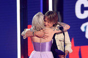 Julia Michaels and Keith Urban accept an award onstage at the 2019 CMT Music Awards at Bridgestone Arena on June 05, 2019 in Nashville, Tennessee.