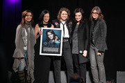 (L-R) Martina McBride, Leslie Fram, Brandi Carlile, Brandy Clark and Tracy Gershon take photos onstage during the 2019 CMT Next Women Of Country at CMA Theater at the Country Music Hall of Fame and Museum on November 12, 2019 in Nashville, Tennessee.