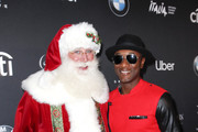 Santa Claus and Aloe Blacc attend Christmas at The Grove: A Festive Tree Lighting celebration at The Grove on November 17, 2019 in Los Angeles, California.