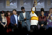 (L-R) Florence Pugh, Cate Shortland, Jeremy Renner, Mahershala Ali, Brian Tyree Henry, Tessa Thompson and Taika Waititi speak at the Marvel Studios Panel during 2019 Comic-Con International at San Diego Convention Center on July 20, 2019 in San Diego, California.