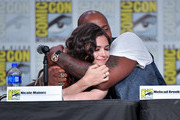 .Nicole Maines and Mehcad Brooks speaks at the 'Supergirl' Special Video Presentation and Q&A during 2019 Comic-Con International at San Diego Convention Center on July 20, 2019 in San Diego, California.