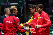 Rafael Nadal of Spain and Denis Shapovalov of Canada exchange pennants ahead of their singles final match during Day Seven of the 2019 Davis Cup at La Caja Magica on November 24, 2019 in Madrid, Spain.
