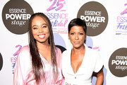 Jemele Hill and Tamron Hall attend 2019 ESSENCE Festival Presented By Coca-Cola at Ernest N. Morial Convention Center on July 05, 2019 in New Orleans, Louisiana.