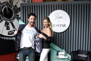 Retransmission with alternate crop.) (L-R) Beau Clark and Stassi Schroeder pose as she presents: Outfit Of The Day Collection exclusively on JustFab, on #NationalOOTDDay at Norah on June 25, 2019 in West Hollywood, California.