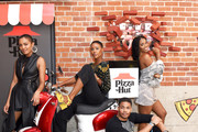 (L-R) China Anne McClain, Christine Adams, Jordan Calloway, and Nafessa Williams of 'Black Lightning' attend the Pizza Hut Lounge at 2019 Comic-Con International: San Diego on July 20, 2019 in San Diego, California.