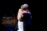 Charlize Theron and Kate McKinnon embrace onstage at the 2019 Glamour Women Of The Year Awards at Alice Tully Hall on November 11, 2019 in New York City. (Photo by Ilya S. Savenok/Getty Images for Glamour
