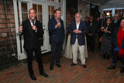 Stuart Suna speaks as Alec Baldwin and Randy Mastro look on at the Chairman's Reception during the 2019 Hamptons International Film Festival on October 12, 2019 in East Hampton, New York.