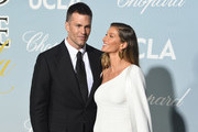 (L-R) Tom Brady and Gisele Bündchen attends the 2019 Hollywood For Science Gala at Private Residence on February 21, 2019 in Los Angeles, California.