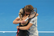 Angelique Kerber and Alexander Zverev of Germany celebrate winning their mixed doubles match against Garbine Muguruza and David Ferrer of Spain during day two of the 2019 Hopman Cup at RAC Arena on December 30, 2018 in Perth, Australia.