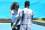 Serena Williams and Frances Tiafoe of the United States share a moment on the practice court during day two of the 2019 Hopman Cup at RAC Arena on December 30, 2018 in Perth, Australia.