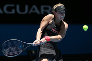Angelique Kerber of Germany plays a backhand in her singles match against Garbine Muguruza of Spain during day two of the 2019 Hopman Cup at RAC Arena on December 30, 2018 in Perth, Australia.