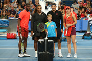 Frances Tiafoe and Serena Williams of the United States stand with Roger Federer and Belinda Bencic of Switzerland following the coin toss before the mixed doubles match during day four of the 2019 Hopman Cup at RAC Arena on January 01, 2019 in Perth, Australia.