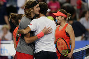 Maria Sakkari and Stefanos Tsitsipas of Greece and Belinda Bencic and Roger Federer of Switzerland embrace at the net in the mixed doubles match during day six of the 2019 Hopman Cup at Perth Arena on January 03, 2019 in Perth, Australia.