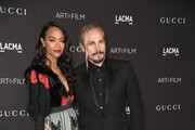 (L-R) Zoe Saldana and Marco Perego attend the 2019 LACMA Art + Film Gala Presented By Gucci at LACMA on November 02, 2019 in Los Angeles, California.
