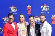 (L-R) Daniel Levy, Annie Murphy, Noah Reid, and Dustin Milligan attend the 2019 MTV Movie and TV Awards at Barker Hangar on June 15, 2019 in Santa Monica, California.