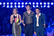 (L-R) Kiernan Shipka, Ross Lynch and Gavin Leatherwood present onstage during the 2019 MTV Movie and TV Awards at Barker Hangar on June 15, 2019 in Santa Monica, California.