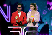 (L-R) Daniel Levy and Annie Murphy speak onstage during the 2019 MTV Movie and TV Awards at Barker Hangar on June 15, 2019 in Santa Monica, California.