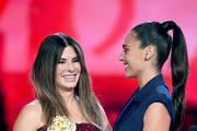 (L-R) Sandra Bullock accepts the Most Frightened Performance award for 'Bird Box' from Gal Gadot onstage during the 2019 MTV Movie and TV Awards at Barker Hangar on June 15, 2019 in Santa Monica, California.