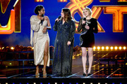 (L-R) Tiffany Haddish, Melissa McCarthy, and Elisabeth Moss speak onstage during the 2019 MTV Movie and TV Awards at Barker Hangar on June 15, 2019 in Santa Monica, California.