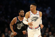 Russell Westbrook #0 of the Oklahoma City Thunder and Team Giannis reacts alongside Dwyane Wade #3 of the Miami Heat and Team LeBron during the NBA All-Star game as part of the 2019 NBA All-Star Weekend at Spectrum Center on February 17, 2019 in Charlotte, North Carolina. Team LeBron won 178-164. NOTE TO USER: User expressly acknowledges and agrees that, by downloading and/or using this photograph, user is consenting to the terms and conditions of the Getty Images License Agreement.