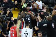 Kawhi Leonard #2 of the Toronto Raptors and Draymond Green #23 of the Golden State Warriors embrace after Game Six of the 2019 NBA Finals at ORACLE Arena on June 13, 2019 in Oakland, California. NOTE TO USER: User expressly acknowledges and agrees that, by downloading and or using this photograph, User is consenting to the terms and conditions of the Getty Images License Agreement.