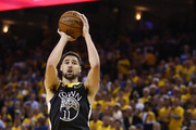 Klay Thompson #11 of the Golden State Warriors attempts a jump shot against the Toronto Raptors in the first half during Game Six of the 2019 NBA Finals at ORACLE Arena on June 13, 2019 in Oakland, California. NOTE TO USER: User expressly acknowledges and agrees that, by downloading and or using this photograph, User is consenting to the terms and conditions of the Getty Images License Agreement.