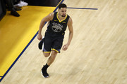 Klay Thompson #11 of the Golden State Warriors celebrates the basket against the Toronto Raptors in the first half during Game Six of the 2019 NBA Finals at ORACLE Arena on June 13, 2019 in Oakland, California. NOTE TO USER: User expressly acknowledges and agrees that, by downloading and or using this photograph, User is consenting to the terms and conditions of the Getty Images License Agreement.