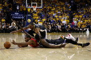 Kawhi Leonard #2 of the Toronto Raptors battles for the ball with Andre Iguodala #9 and Draymond Green #23 of the Golden State Warriors in the second half during Game Six of the 2019 NBA Finals at ORACLE Arena on June 13, 2019 in Oakland, California. NOTE TO USER: User expressly acknowledges and agrees that, by downloading and or using this photograph, User is consenting to the terms and conditions of the Getty Images License Agreement.