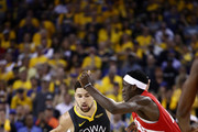 Klay Thompson #11 of the Golden State Warriors is defended by Pascal Siakam #43 of the Toronto Raptors in the first half during Game Six of the 2019 NBA Finals at ORACLE Arena on June 13, 2019 in Oakland, California. NOTE TO USER: User expressly acknowledges and agrees that, by downloading and or using this photograph, User is consenting to the terms and conditions of the Getty Images License Agreement.