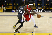 Pascal Siakam #43 of the Toronto Raptors is defended by Draymond Green #23 of the Golden State Warriors in the first half during Game Six of the 2019 NBA Finals at ORACLE Arena on June 13, 2019 in Oakland, California. NOTE TO USER: User expressly acknowledges and agrees that, by downloading and or using this photograph, User is consenting to the terms and conditions of the Getty Images License Agreement.